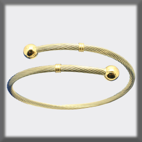 CABLE BRACELET IN STAINLESS STEEL WITH 2 BALLS IN GOLD